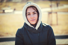Young thoughtful woman in hood Stock Photos