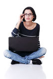 Young thoughtful woman with a laptop Stock Image