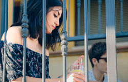 Young thoughtful woman sitting outdoors on home Stock Photography