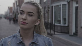 Young thoughtful woman walking in the city streets. stock video