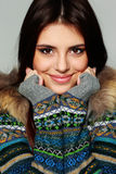Young thoughtful woman in warm winter outfit Stock Images
