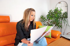 Young thoughtful young woman reading papers Stock Photography