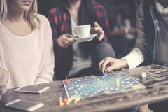 Three girls play together a social game. Focus on hand. royalty free stock photo