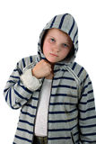 Young thug in gray hood with fist under chin Royalty Free Stock Image