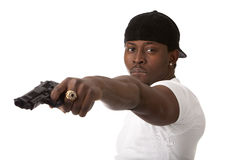 Young thug with a gun Royalty Free Stock Images