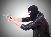 Young thug with gun isolated on white Stock Photo