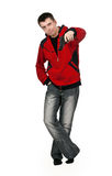 Young thug in a red sweater with a gun Royalty Free Stock Image