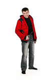 Young thug in a red sweater with a gun Royalty Free Stock Photography
