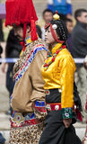 Young Tibetan Couple in Yunnan Province. A young Tibetan couple dressed in traditional clothing for a parade in the Tibetan region of northern Yunnan province in Stock Image