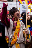 Young Tibetan yelling. Protesting for a free Tibet, near of the Chinese embassy. Paris, March 10th, 2012 Stock Photo