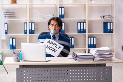 The young tied male employee in the office. Young tied male employee in the office royalty free stock image