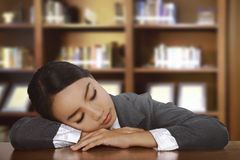 Young Tired Asian Woman Sleeping On Desk Stock Image