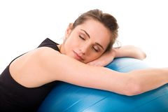 Young tired, attractive female with fitness ball Royalty Free Stock Images