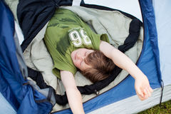 Young Tired Boy Sleeping In Tent Stock Image