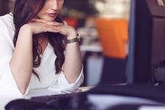 Young tired business woman with headache sitting in workplace Royalty Free Stock Image