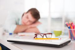 Young tired businessman sleeping while working day Royalty Free Stock Image