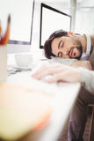 Young tired businessman taking nap in office Stock Photo