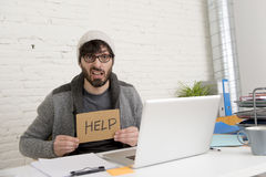 Young tired hispanic hipster businessman busy asking for help suffering stress Royalty Free Stock Images