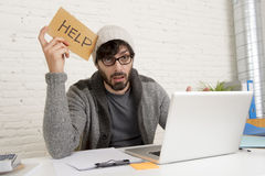 Young tired hispanic hipster businessman busy asking for help suffering stress Stock Image