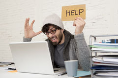 Young tired hispanic hipster businessman busy asking for help suffering stress Royalty Free Stock Image