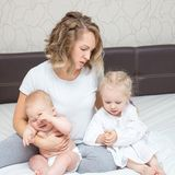 Young tired mother with her two kids royalty free stock image