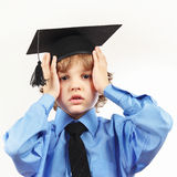 Young tired professor in academic hat on white background Stock Image
