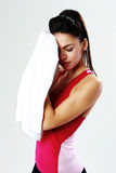 Young tired sport woman with towel Stock Photo