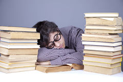 The young tired student with the books isolated. Stock Photography