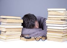 The young tired student with the books isolated. Royalty Free Stock Photography