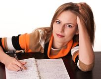 Young tired student on the desk dreaming Royalty Free Stock Images