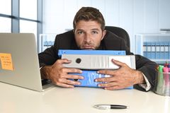 Businessman working in stress at office laptop computer looking exhausted and overwhelmed royalty free stock images