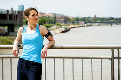 Young tired woman rest after run in the city over the bridge. Stock Images
