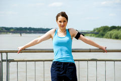 Young tired woman rest after run in the city over the bridge. Royalty Free Stock Image