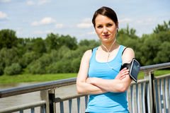 Young tired woman rest after run in the city over the bridge. Stock Photography