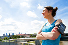 Young tired woman rest after run in the city over the bridge. Royalty Free Stock Photo