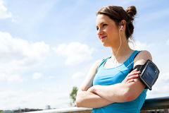 Young tired woman rest after run in the city over the bridge. Stock Image