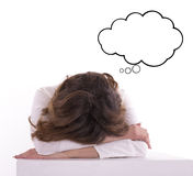 Young tired woman student sleeping on the table Royalty Free Stock Image