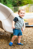 Young toddler boy child playing on slide Royalty Free Stock Photos