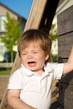 Young toddler crying at the park Royalty Free Stock Photo