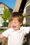 Young toddler crying at the park Royalty Free Stock Photos
