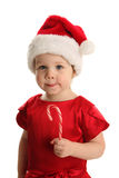 Young toddler girl with a Christmas candy cane Royalty Free Stock Photos