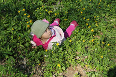 Girl lying grass Stock Images