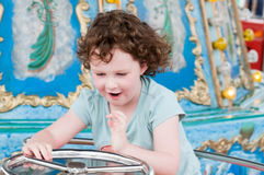 Young toddler girl having fun on boardwalk amusement ride Stock Photography