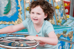 Young toddler girl having fun on boardwalk amusement ride Royalty Free Stock Photography