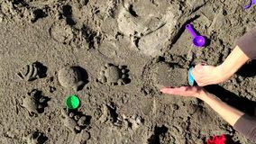 Young toddler playing with his mother on the beach. Young toddler playing with sand and toys on a beach stock video