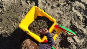 Young toddler playing with sand stock footage
