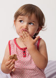 Young toddler thinking after eating too much chocolate Royalty Free Stock Photography
