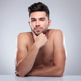 Young topless man is thinking Royalty Free Stock Image