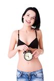 Young topless woman with alarmclock Stock Image