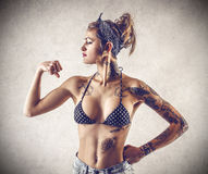 Young tough woman with tattoos Royalty Free Stock Image
